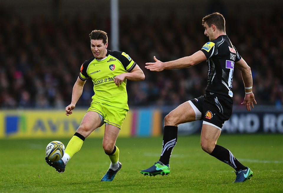 EXETER, ENGLAND - DECEMBER 24:  Freddie Burns of Leicester Tigers kicks past Ollie Devoto of Exeter Chiefs during the Aviva Premiership match between Exeter Chiefs and Leicester Tigers at Sandy Park on December 24, 2016 in Exeter, England. (Photo by Dan Mullan/Getty Images)