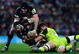EXETER, UNITED KINGDOM - DECEMBER 24: Don Armand of Exeter Chiefs is tackled by Mike Williams of Leicester Tigers during the Aviva Premiership match between Exeter Chiefs and Leicester Tigers at Sandy Park on December 24 2016 in Exeter, England. (Photo by Harry Trump/Getty Images)