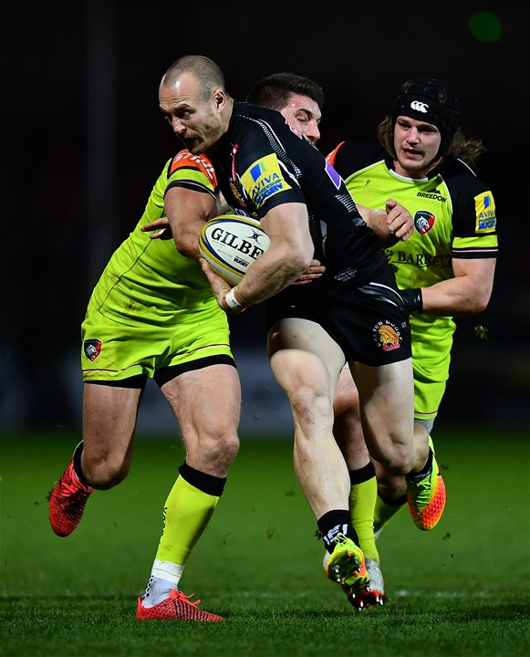 EXETER, ENGLAND - DECEMBER 24:  James Short of Exeter Chiefs makes a break past Owen Williams of Leicester Tigers during the Aviva Premiership match between Exeter Chiefs and Leicester Tigers at Sandy Park on December 24, 2016 in Exeter, England. (Photo by Dan Mullan/Getty Images)