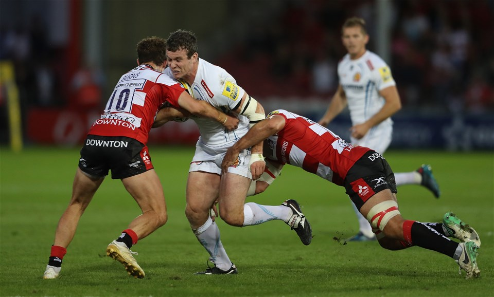 GLOUCESTER, ENGLAND - SEPTEMBER 01:  Ian Whitten of Exeter is tackled by Billy Burns (L) and Lewis Ludlow during the Aviva Premiership match between Gloucester Rugby and Exeter Chiefs at Kingsholm Stadium on September 1, 2017 in Gloucester, England.  (Photo by David Rogers/Getty Images)