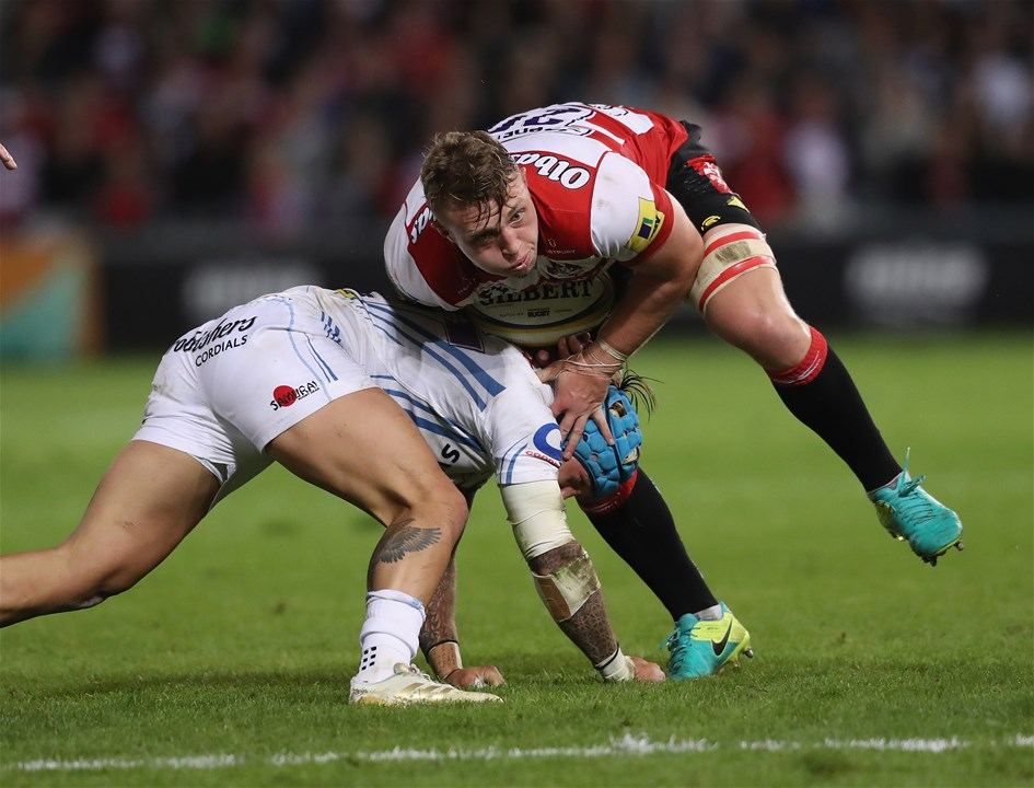 GLOUCESTER, ENGLAND - SEPTEMBER 01:  Ruan Ackermann of Gloucester is tackled by Jack Nowell during the Aviva Premiership match between Gloucester Rugby and Exeter Chiefs at Kingsholm Stadium on September 1, 2017 in Gloucester, England.  (Photo by David Rogers/Getty Images)