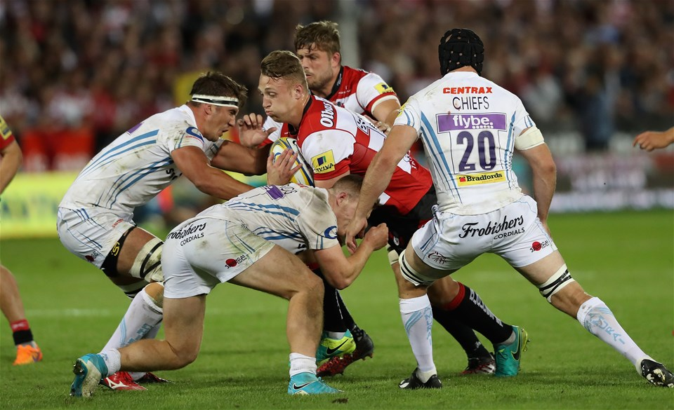 GLOUCESTER, ENGLAND - SEPTEMBER 01:  Ruan Ackermann of Gloucester is tackled during the Aviva Premiership match between Gloucester Rugby and Exeter Chiefs at Kingsholm Stadium on September 1, 2017 in Gloucester, England.  (Photo by David Rogers/Getty Images)