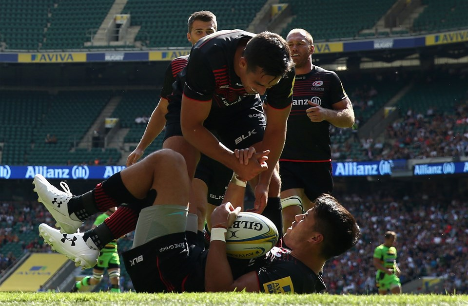 LONDON, ENGLAND - SEPTEMBER 02:  Sean Maitland of Saracens, is congratulated by team mate Alex Lozowski after scoring his first try of a first half hat-trick during the Aviva Premiership match between Saracens and Northampton Saints at Twickenham Stadium on September 2, 2017 in London, England.  (Photo by David Rogers/Getty Images)