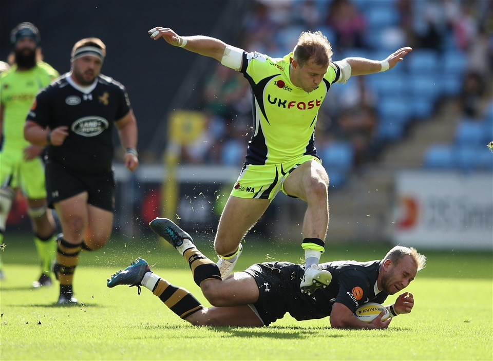 COVENTRY, ENGLAND - SEPTEMBER 02:  Will Addison of Sale Sharks jumps over Dan Robson of Wasps during the Aviva Premiership match between Wasps and Sale Sharks at The Ricoh Arena on September 2, 2017 in Coventry, England.  (Photo by Clive Mason/Getty Images)
