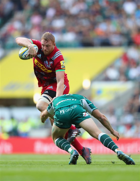 LONDON, ENGLAND - SEPTEMBER 02:   George Merrick of Harlequins is tackled by Greig Tonks of London Irish during the Aviva Premiership match between London Irish and Harlequins at Twickenham Stadium on September 2, 2017 in London, England.  (Photo by Warren Little/Getty Images)