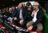 LEICESTER, ENGLAND - SEPTEMBER 03:  Nick Mullins, (R) the BT Sport rugby commentator watches the match with pundits Lawrence Dallaglio and Austin Healey during the Aviva Premiership match between Leicester Tigers and Bath Rugby at Welford Road on September 3, 2017 in Leicester, England.  (Photo by David Rogers/Getty Images)