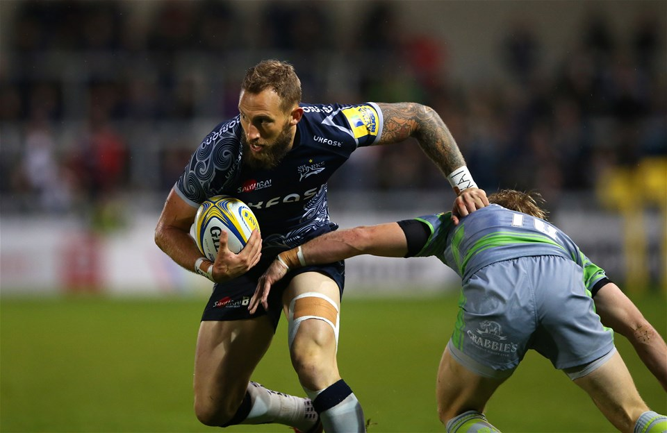SALFORD, ENGLAND - SEPTEMBER 08:  Byron McGuigan of Sale Sharks beats Joel Hodgson of Newcastle Falcons during the Aviva Premiership match between Sale Sharks and Newcastle Falcons at AJ Bell Stadium on September 8, 2017 in Salford, England.  (Photo by Alex Livesey/Getty Images)