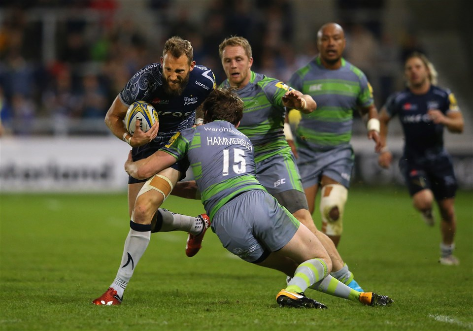 SALFORD, ENGLAND - SEPTEMBER 08:  Byron McGuigan of Sale Sharks is tackled by Simon Hammersley of Newcastle Falcons during the Aviva Premiership match between Sale Sharks and Newcastle Falcons at AJ Bell Stadium on September 8, 2017 in Salford, England.  (Photo by Alex Livesey/Getty Images)