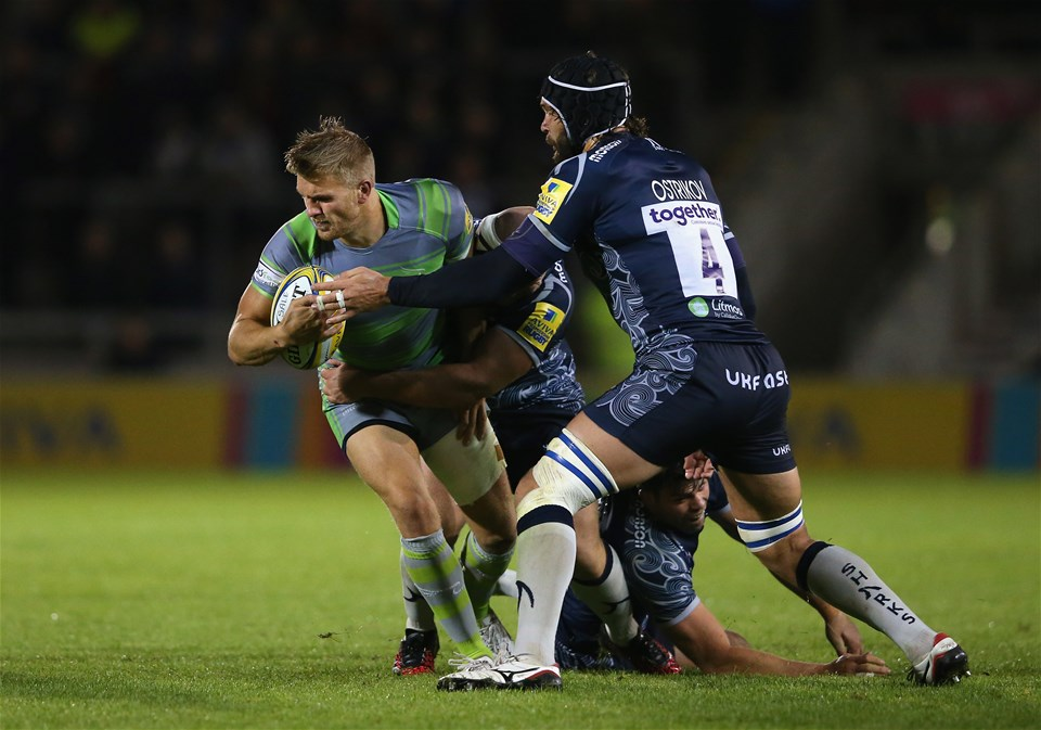 SALFORD, ENGLAND - SEPTEMBER 08:  Chris Harris of Newcastle Falcons is tackled by Andre Ostrikov of Sale Sharks during the Aviva Premiership match between Sale Sharks and Newcastle Falcons at AJ Bell Stadium on September 8, 2017 in Salford, England.  (Photo by Alex Livesey/Getty Images)