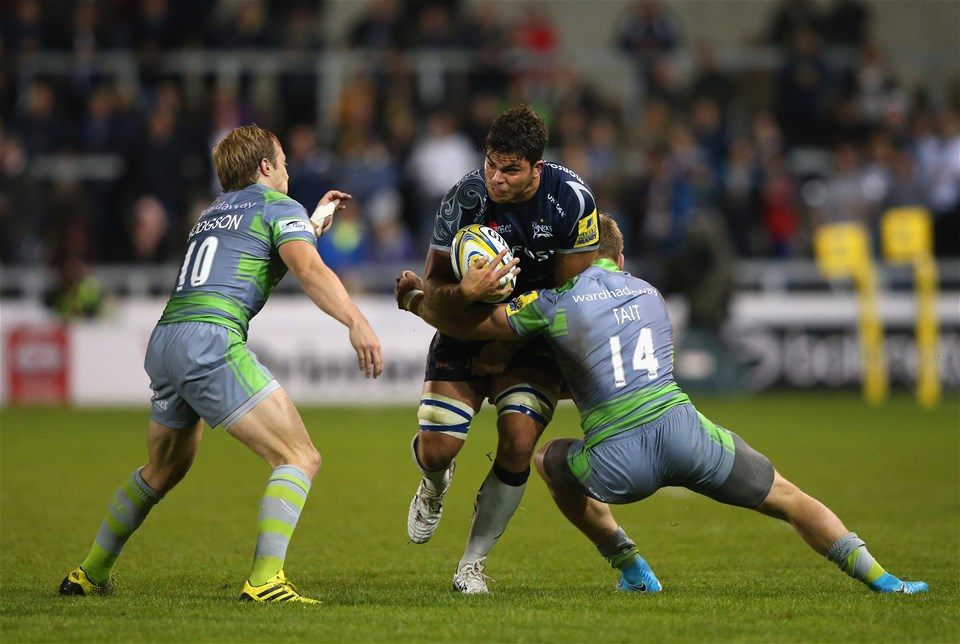 SALFORD, ENGLAND - SEPTEMBER 08:  Jono Ross of Sale Sharks is tackled by Joel Hodgson and Alex Tait of Newcastle Falcons during the Aviva Premiership match between Sale Sharks and Newcastle Falcons at AJ Bell Stadium on September 8, 2017 in Salford, England.  (Photo by Alex Livesey/Getty Images)