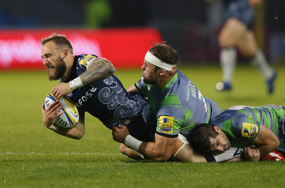 SALFORD, ENGLAND - SEPTEMBER 08:  Byron McGuigan of Sale Sharks is tackled by Will Welch of Newcastle Falcons during the Aviva Premiership match between Sale Sharks and Newcastle Falcons at AJ Bell Stadium on September 8, 2017 in Salford, England.  (Photo by Alex Livesey/Getty Images)