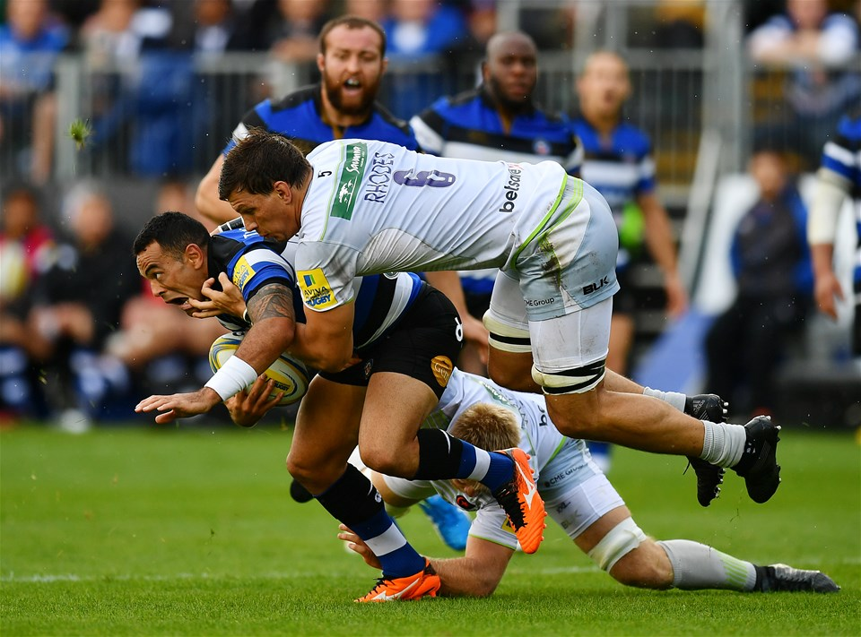 BATH, ENGLAND - SEPTEMBER 09:  Kahn Fotualii of Bath is tackled by Michael Rhodes and Jackson Wray of Saracens during the Aviva Premiership match between Bath Rugby and Saracens at Recreation Ground on September 9, 2017 in Bath, England. (Photo by Dan Mullan/Getty Images)