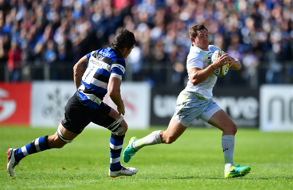 BATH, ENGLAND - SEPTEMBER 09:  Alex Goode of Saracens takes on Francois Louw of Bath during the Aviva Premiership match between Bath Rugby and Saracens at Recreation Ground on September 9, 2017 in Bath, England. (Photo by Dan Mullan/Getty Images)
