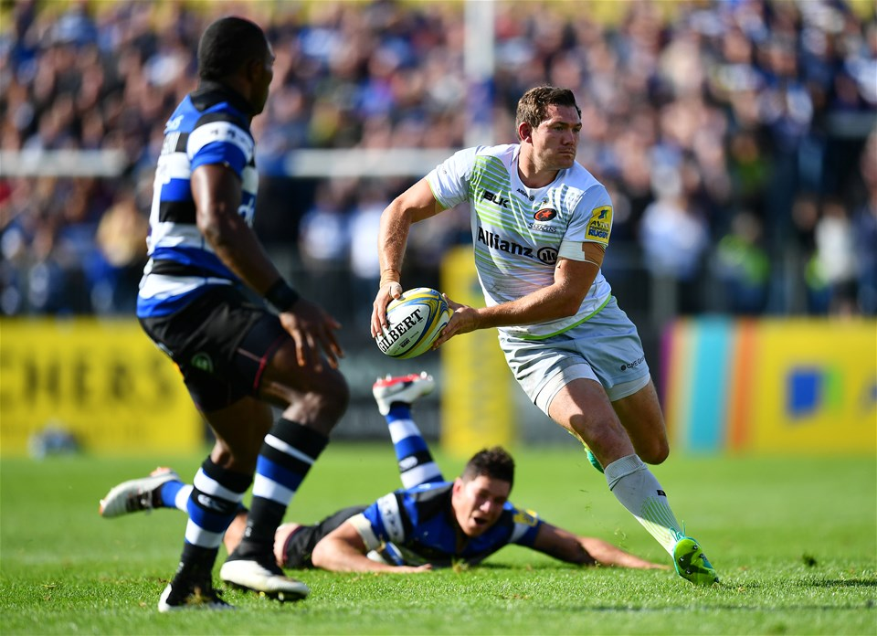 BATH, ENGLAND - SEPTEMBER 09:  Alex Goode of Saracens takes on Semesa Rokoduguni of Bath during the Aviva Premiership match between Bath Rugby and Saracens at Recreation Ground on September 9, 2017 in Bath, England. (Photo by Dan Mullan/Getty Images)