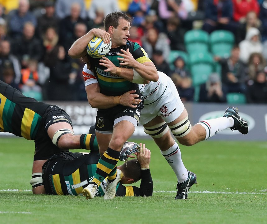NORTHAMPTON, ENGLAND - SEPTEMBER 09: Nic Groom of Northampton is tackled during the Aviva Premiership match between Northampton Saints and Leicester Tigers at Franklin's Gardens on September 9, 2017 in Northampton, England.  (Photo by David Rogers/Getty Images)