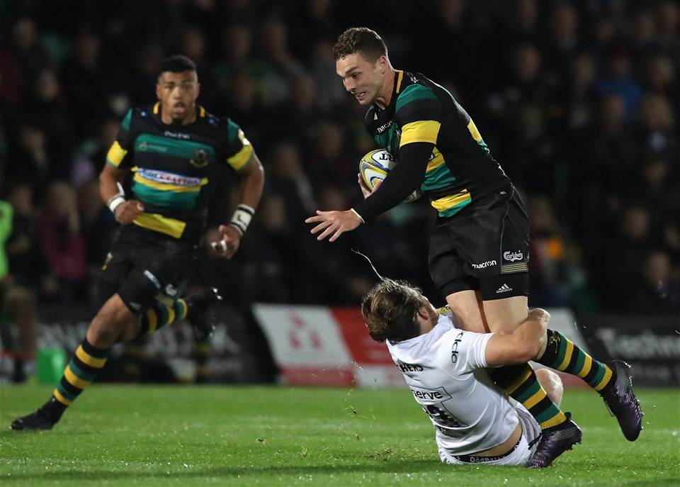 NORTHAMPTON, ENGLAND - SEPTEMBER 15:  George North of Northampton is tackled by Max Clark during the Aviva Premiership match between Northampton Saints and Bath Rugby at Franklin's Gardens on September 15, 2017 in Northampton, England.  (Photo by David Rogers/Getty Images)