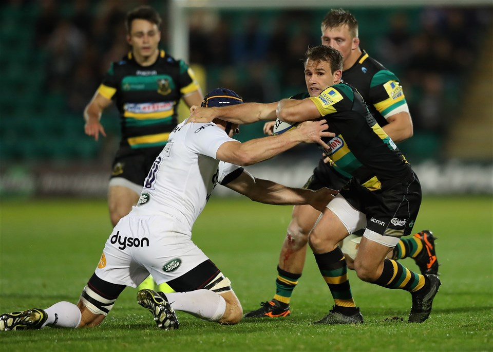 NORTHAMPTON, ENGLAND - SEPTEMBER 15:  Nic Groom of Northampton is tackled by Paul Grant during the Aviva Premiership match between Northampton Saints and Bath Rugby at Franklin's Gardens on September 15, 2017 in Northampton, England.  (Photo by David Rogers/Getty Images)
