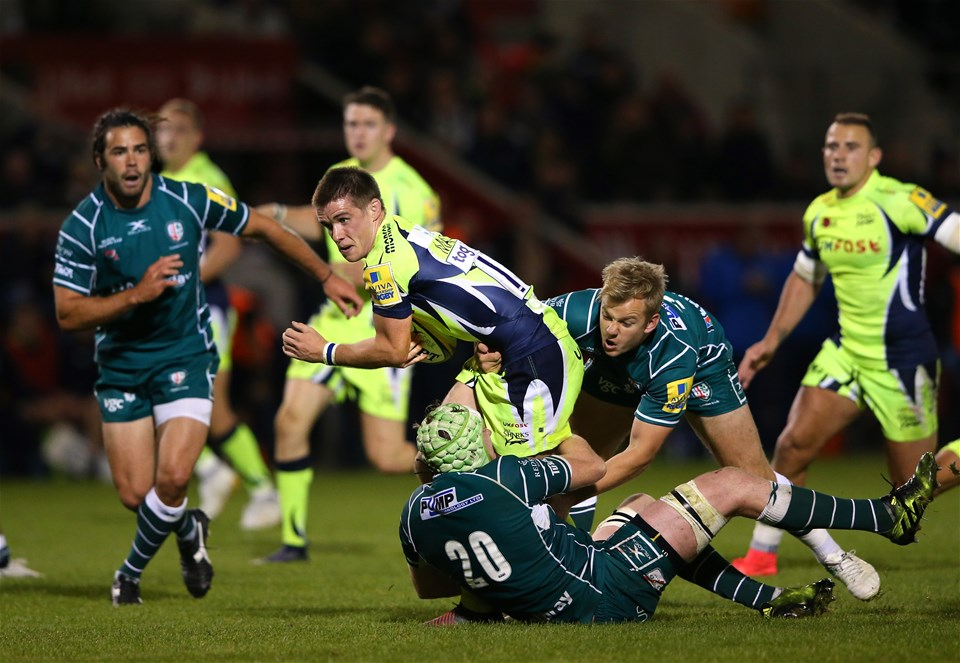 SALFORD, ENGLAND - SEPTEMBER 15:  AJ MacGinty of Sale Sharks is tackled by Scott Steele of London Irish during the Aviva Premiership match between Sale Sharks and London Irish at AJ Bell Stadium on September 15, 2017 in Salford, England.  (Photo by Alex Livesey/Getty Images)