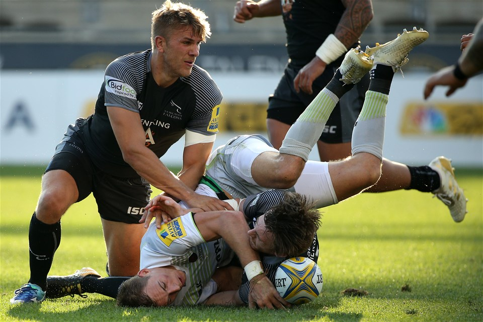 CHESTER, PA - SEPTEMBER 16: Liam Williams #14 of the Saracens is tackled by Simon Hammersley #15 of the Newcastle Falcons during a Aviva Premiership match between the Newcastle Falcons and the Saracens at Talen Energy Stadium on September 16, 2017 in Chester, Pennsylvania. (Photo by Patrick Smith/Getty Images)
