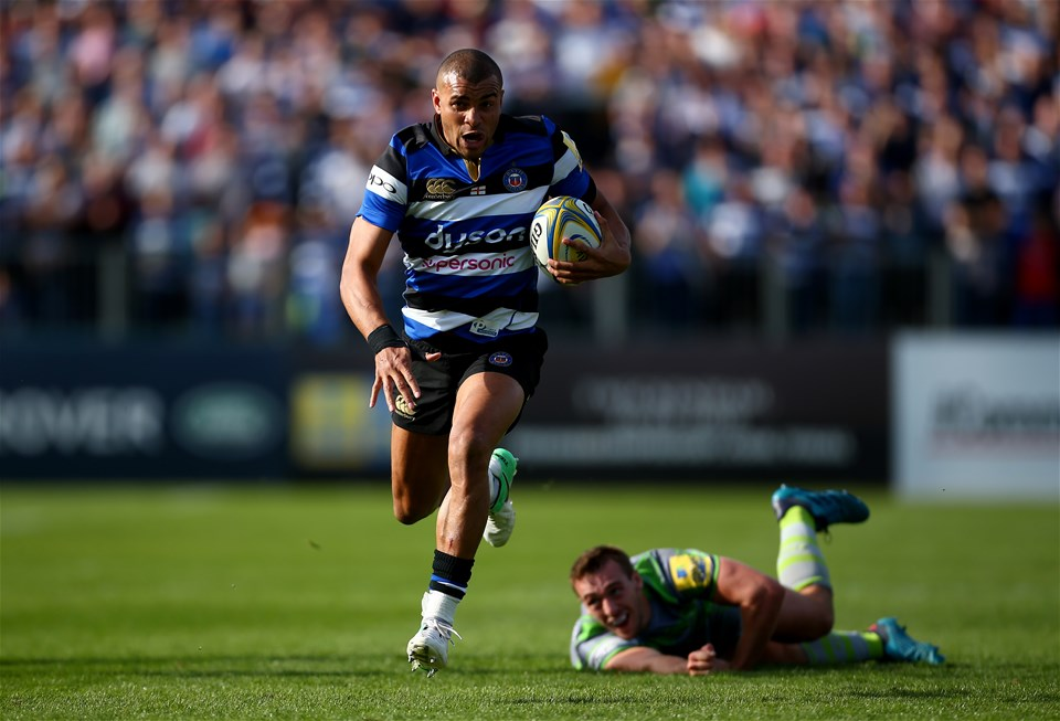 BATH, ENGLAND - SEPTEMBER 23:  Jonathan Joseph of Bath avoids a tackle from Chris Harris of Newcastle during the Aviva Premiership match between Bath Rugby and Newcastle Falcons at Recreation Ground on September 23, 2017 in Bath, England.  (Photo by Jordan Mansfield/Getty Images)