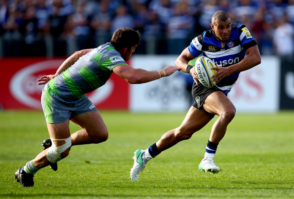BATH, ENGLAND - SEPTEMBER 23:  Jonathan Joseph of Bath avoids a tackle from DTH van der Merwe of Newcastle during the Aviva Premiership match between Bath Rugby and Newcastle Falcons at Recreation Ground on September 23, 2017 in Bath, England.  (Photo by Jordan Mansfield/Getty Images)