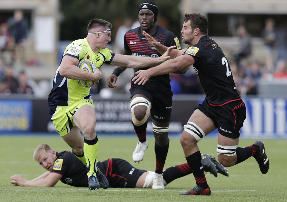 BARNET, ENGLAND - SEPTEMBER 23: Tom Curry of Sale Sharks hands off Calum Clark of Saracens during the Aviva Premiership match between Saracens and Sale Sharks at Allianz Park on September 23, 2017 in Barnet, England. (Photo by Henry Browne/Getty Images)