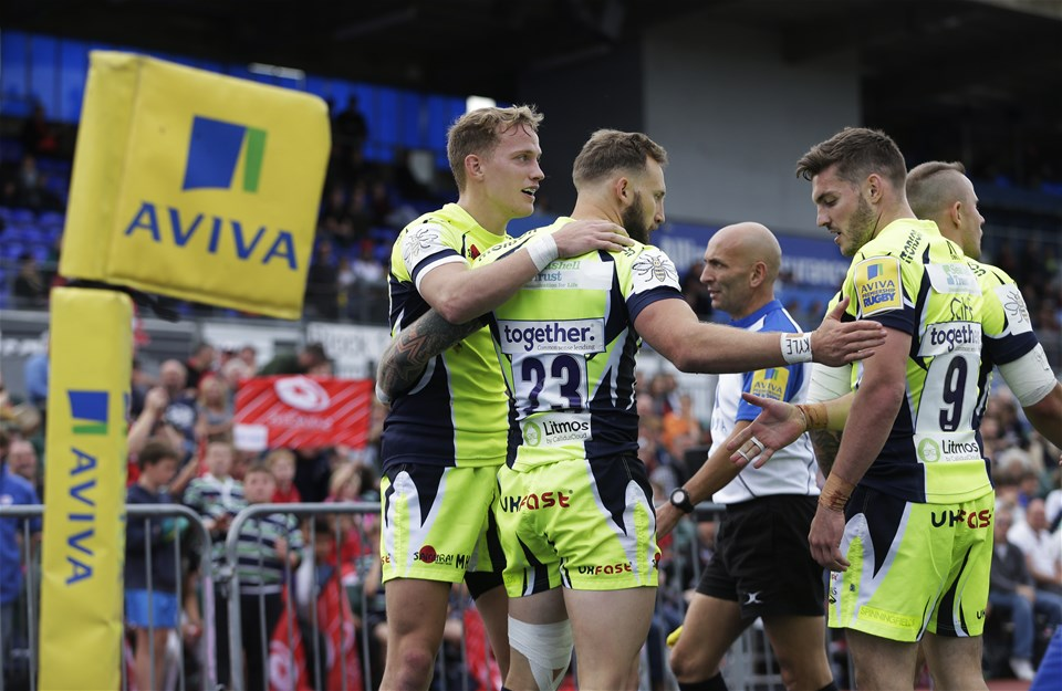 BARNET, ENGLAND - SEPTEMBER 23: Byron McGuigan of Sale Sharks is congratulated by team mates after scoring their first try during the Aviva Premiership match between Saracens and Sale Sharks at Allianz Park on September 23, 2017 in Barnet, England. (Photo by Henry Browne/Getty Images)