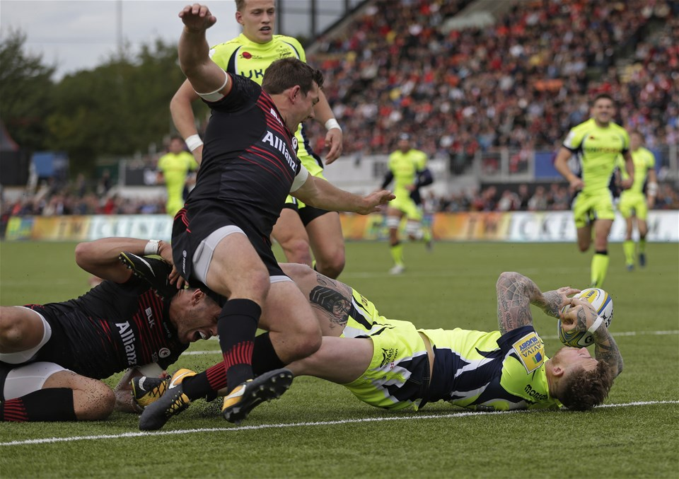 BARNET, ENGLAND - SEPTEMBER 23: Josh Charnley of Sale Sharks is prevented from scoring a try by Sean Maitland (l) of Saracens during the Aviva Premiership match between Saracens and Sale Sharks at Allianz Park on September 23, 2017 in Barnet, England. (Photo by Henry Browne/Getty Images)