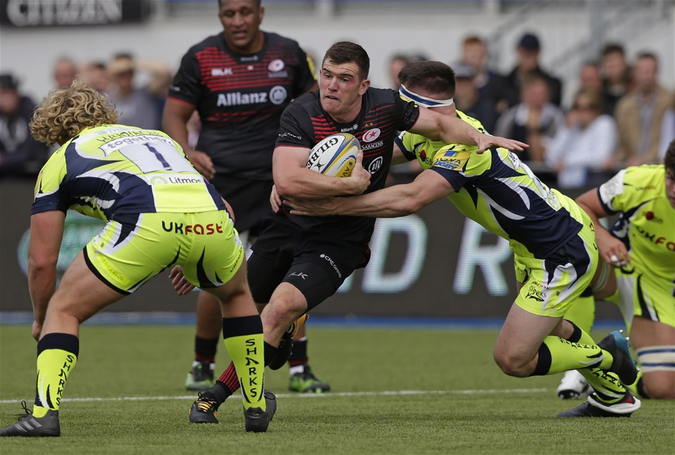 BARNET, ENGLAND - SEPTEMBER 23: Ben Spencer of Saracens tackled by Tom Curry of Sale Sharks during the Aviva Premiership match between Saracens and Sale Sharks at Allianz Park on September 23, 2017 in Barnet, England. (Photo by Henry Browne/Getty Images)